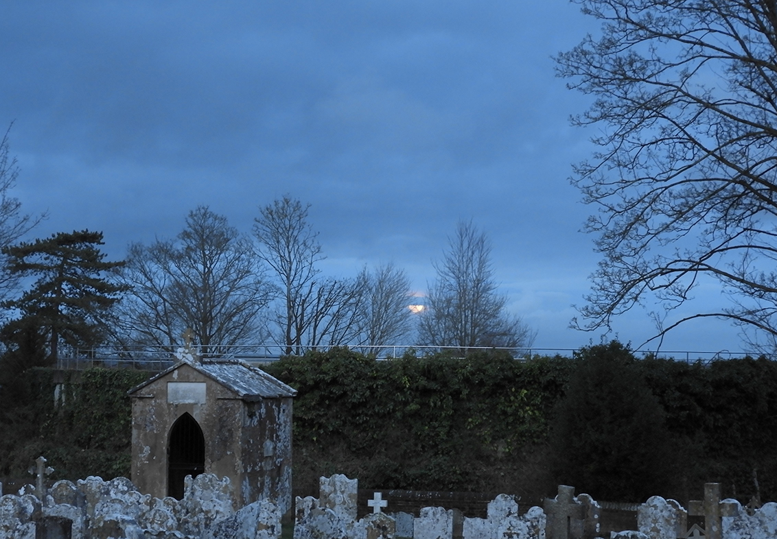 St James' RC cemetery with nascent supermoon and some typically crass railing.